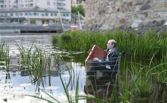 Waiting for the waters to rise. Isaac Cordal's street art critiques the lack of urgency about climate change.
